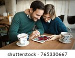 young attractive couple using... | Shutterstock . vector #765330667