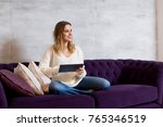 young woman with tablet on... | Shutterstock . vector #765346519