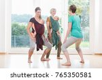 young women wearing babies for... | Shutterstock . vector #765350581