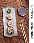 sushi set on pottery plate with ...   Shutterstock . vector #765368371