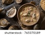 Small photo of Homemade oyster stew with stout beer, bacon, and thyme.