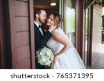 newlyweds embracing at the door ... | Shutterstock . vector #765371395