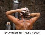 man washing hair in shower   Shutterstock . vector #765371404