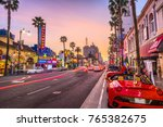 Small photo of LOS ANGELES, CALIFORNIA - MARCH 1, 2016: Traffic on Hollywood Boulevard at dusk. The theater district is a famous tourist attraction.