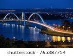 at nightfall the lights go on... | Shutterstock . vector #765387754