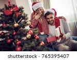 romantic couple exchanging... | Shutterstock . vector #765395407