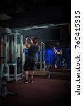 young male athlete bodybuilder... | Shutterstock . vector #765415315