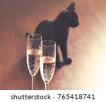 Stock photo black cat and champagne vintage grained background good luck concept 765418741