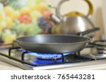 frying pan on a stove   Shutterstock . vector #765443281