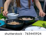 woman hands cooked in a two... | Shutterstock . vector #765445924