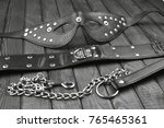 Stock photo bdsm fetish sex toys bondage composition leather mask chain neck collar black and white art 765465361