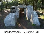 a dolmen in the woods south... | Shutterstock . vector #765467131