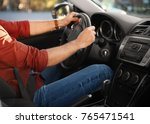 man on driver seat of car | Shutterstock . vector #765471541