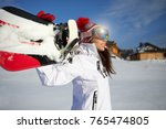 a young woman snowboarding in... | Shutterstock . vector #765474805