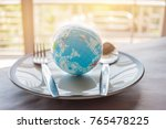 globe model placed on plate... | Shutterstock . vector #765478225