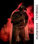 Small photo of Theatrical lighitng, special effects, and a leather mask bring this evil plague doctor variation to life. Halloween/horror inspired