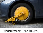 car wheel blocked by wheel lock ... | Shutterstock . vector #765483397