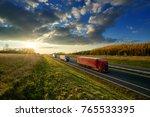 Three Trucks Driving On A...