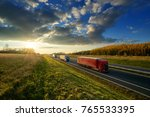 three trucks driving on a... | Shutterstock . vector #765533395