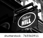 Small photo of Salisbury, Wiltshire, England - November 28, 2017: Monochrome William Hill bookmakers sign, company founded by William Hill in 1934 at a time when gambling was illegal in Britain