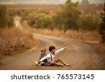 children walk in the park on a...   Shutterstock . vector #765573145