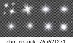set of golden glowing lights... | Shutterstock .eps vector #765621271