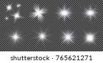 set of golden glowing lights... | Shutterstock .eps vector #765621271