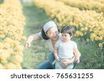 mom and daughter playing for... | Shutterstock . vector #765631255