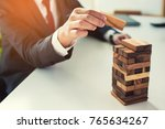 businessman domino picked some... | Shutterstock . vector #765634267
