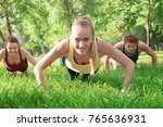 group of young people training... | Shutterstock . vector #765636931