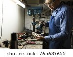 a man is working in a workshop | Shutterstock . vector #765639655