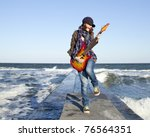 young red haired girl play on... | Shutterstock . vector #76564351