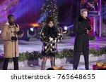 Small photo of New York, NY - Nov 29, 2017: Matt Sallee, Kirstin Moldanado, Scott Hoying of the acappella group Pentatonix performs during the 85th Rockefeller Center Christmas Tree Lighting at Rockefeller Center