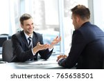 business partners talking while ... | Shutterstock . vector #765658501