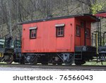 Red Caboose On Railroad Track