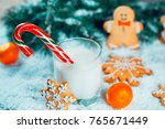 christmas gingerbread and milk... | Shutterstock . vector #765671449