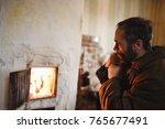 a man with a beard basking near ... | Shutterstock . vector #765677491