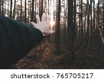 man's hand reaches for the sun  ... | Shutterstock . vector #765705217
