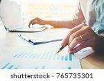 business man holding pen... | Shutterstock . vector #765735301