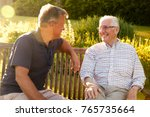 man visiting senior male... | Shutterstock . vector #765735664