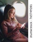 girl is reading from smartphone ... | Shutterstock . vector #765749281