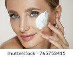 woman face skin care. beautiful ... | Shutterstock . vector #765753415