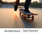 skateboarder legs skateboarding ... | Shutterstock . vector #765754195