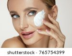 woman face skin care. beautiful ... | Shutterstock . vector #765754399