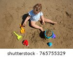 toddler girl playing in the...   Shutterstock . vector #765755329