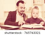 young father helping his... | Shutterstock . vector #765763321