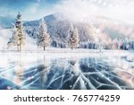 blue ice and cracks on the... | Shutterstock . vector #765774259