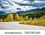 abrupt turn of the road among... | Shutterstock . vector #765785245