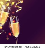 two glasses of champagne on... | Shutterstock .eps vector #765828211