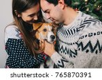 happy couple hugging dog and... | Shutterstock . vector #765870391